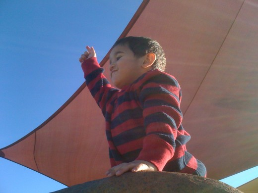 Ethan climbs a rock and proclaims he's Superman!