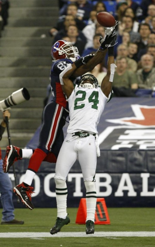 Buffalo Bills' Terrell Owens (81) cannot make the catch under pressure from New York Jets' Darrelle Revis (24) during the first half of an NFL football game at the Rogers Centre in Toronto, Thursday, Dec. 3, 2009. (AP Photo/David Duprey)