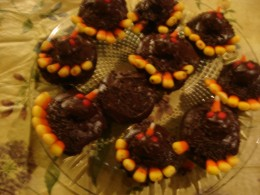 These filled cupcakes were topped with candy corns to make them look  like turkeys on Thanksgiving.