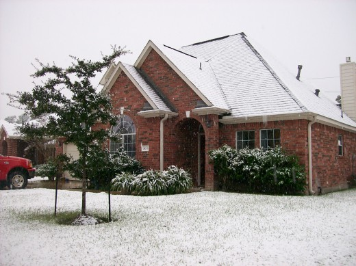 Snow on the House and front yard.