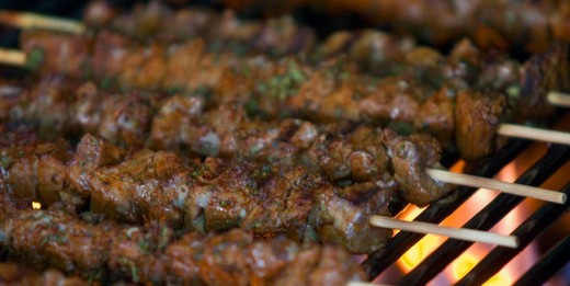 Lamb kebabs over a charcoal fire..