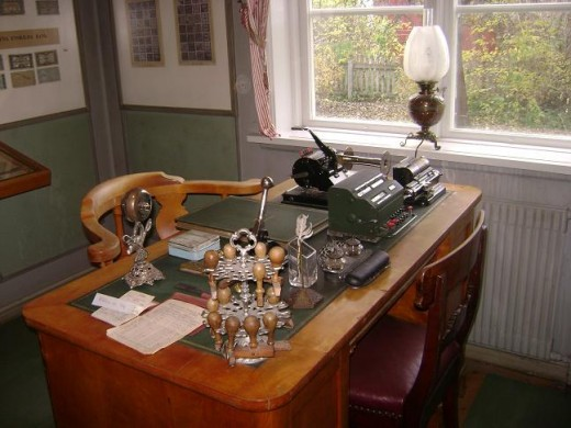 Old Bank desk with old calculators , writing material and ledgers