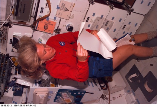 August 1997) --- Astronaut N. Jan Davis, payload commander, looks at the mail from the Thermal Imaging Printing System (TIPS), on flight day four activities onboard the Space Shuttle Discovery:Thanks to NASAimages.org