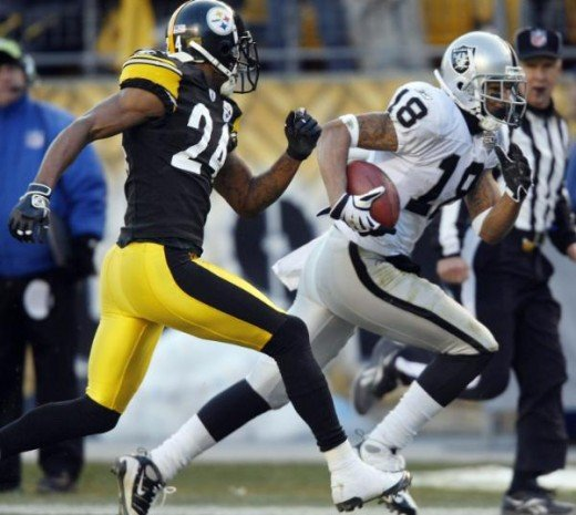 Oakland Raiders wide receiver Louis Murphy, right, runs away from Pittsburgh Steelers cornerback Ike Taylor as he heads to the end zone with one of his touchdowns in the fourth quarter of the NFL football game in Pittsburgh, Sunday, Dec. 6, 2009. The