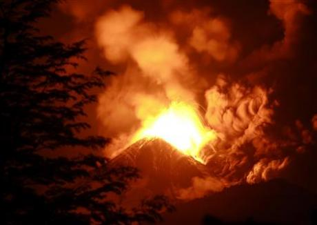 Chile's Llaima volcano belched ash 4 miles into the sky toward neighbouring Argentina.