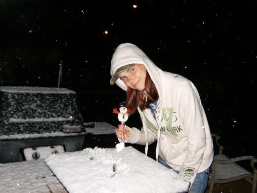 Kim in snow in Houston on our grill.