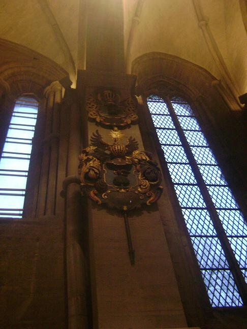 Family crests of Noble families on  display in Linkoping Cathedral walls