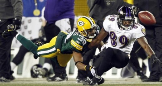 Green Bay Packers' Tramon Williams (38) is called for pass interference on a pass to Baltimore Ravens' Mark Clayton (89) during the first half of an NFL football game Monday, Dec. 7, 2009, in Green Bay, Wis. (AP Photo/Morry Gash)