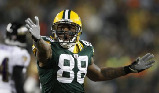 Green Bay Packers' Jermichael Finley reacts after catching a pass during the first half of an NFL football game Monday, Dec. 7, 2009, in Green Bay, Wis. (AP Photo/Jim Prisching)