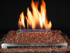 Crushed fire glass in a ventless gas log fireplace has a contemporary look for modern designs by not pretending to be a wood burning fireplace by displaying a striking alternative fire effect.