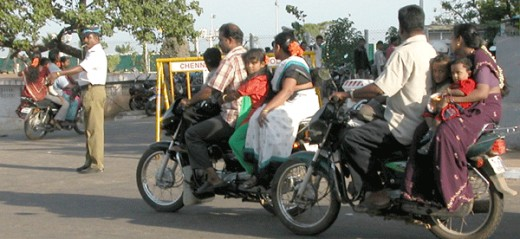 entire families riding a motorbike