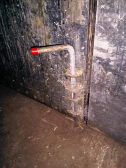 Internal bolt on the bottom of a door.