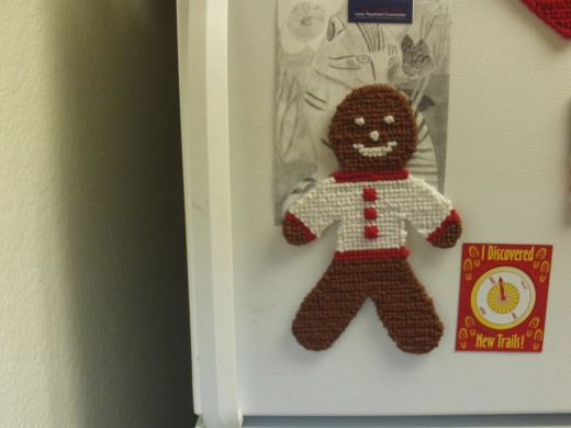 Turn this cute cross stitched gingerbread boy into a magnet for your fridge.