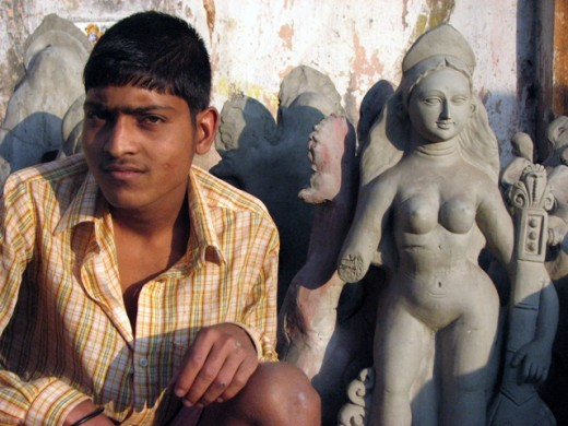 A Potter with his creation. Right hands of Saraswati idols will be fixed later.