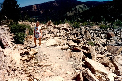My niece walking amidst the rubble that used to be on top of a mountain in the far distance.