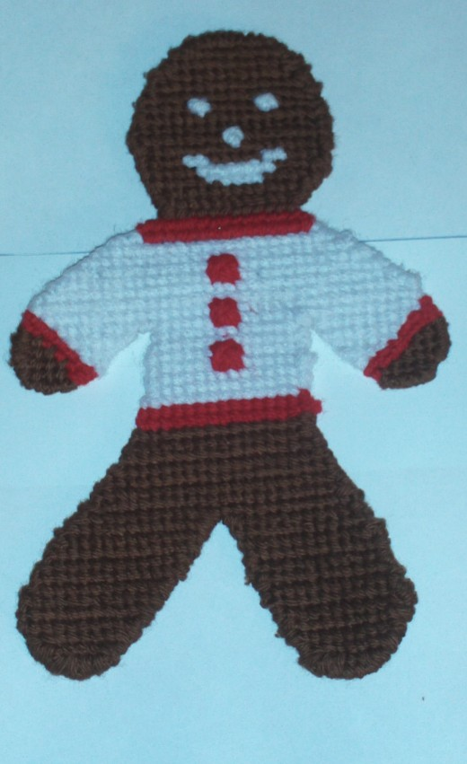 Here I made sure the gingerbread boy was cross stitched neatly.