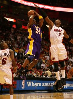 Kobe Bryant shooting over Dwayne Wade