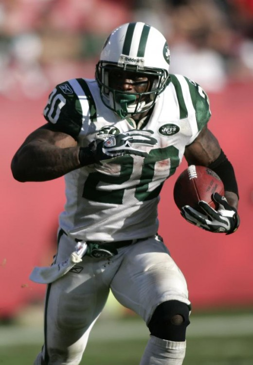 New York Jets running back Thomas Jones (20) runs for his second touchdown of the day against the Tampa Bay Buccaneers during the fourth quarter of an NFL football game Sunday, Dec. 13, 2009, in Tampa, Fla. (AP Photo/Brian Blanco)