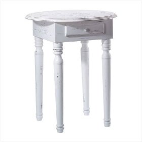 White round end table with antique finish