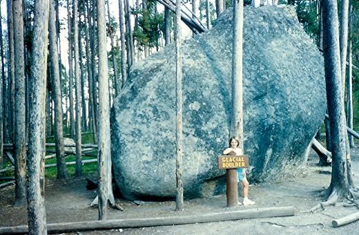 My niece posing in front of a glacier boulder.