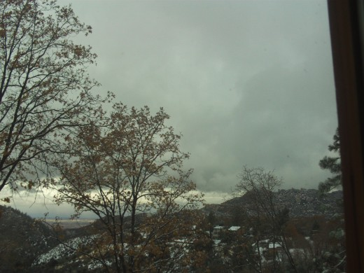 Cloudy skies, beautiful trees, and snow everywhere.