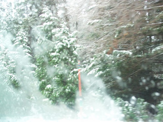 Snow right outside of a car window.