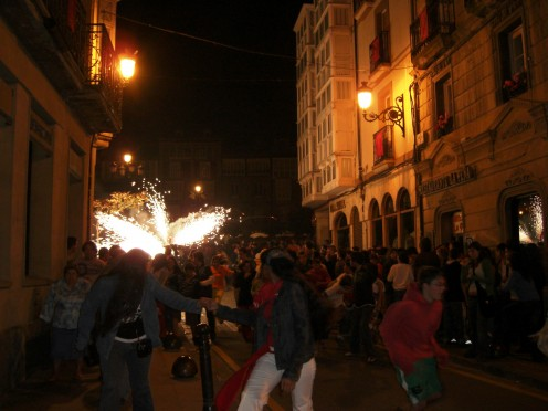 "An ""exploding bull"" chases people out of the plaza after a full day of festivities(Haro,2007)"