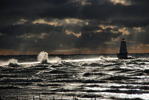 Crepuscular rays from the sun light the Ludington North Breakwater Dec. 14.