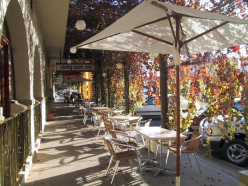 Side walk cafe veiled in grape vines