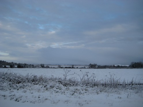 English countryside carpeted with snow