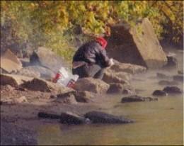 Homeless man beside Ohio River in Cincinnati.