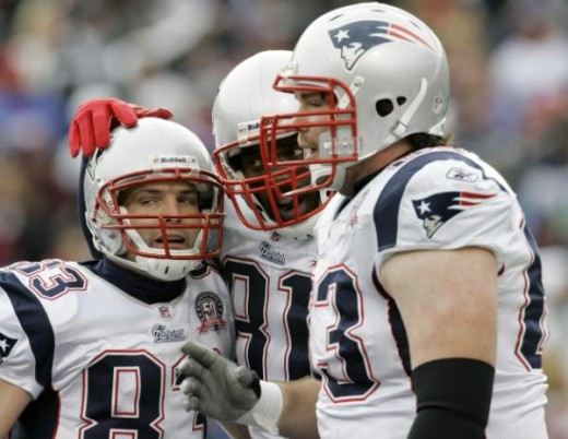 New England Patriots' Randy Moss (81) celebrates his touchdown with teammates Wes Welker (83) and Dan Connolly, right, during the first half of an NFL football game against the Buffalo Bills in Orchard Park, N.Y., Sunday, Dec. 20, 2009. (AP Photo/Dea