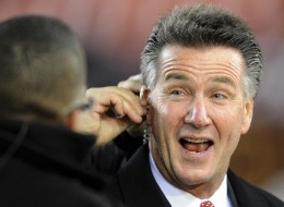 The Washington Redskins' new general manager, Bruce Allen, prepares for a television interview before the Redskins' NFL football game against the New York Giants, Monday, Dec. 21, 2009, in Landover, Md. (AP Photo/Nick Wass)