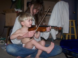 Kaycee, age two, learning how to hold the violin.