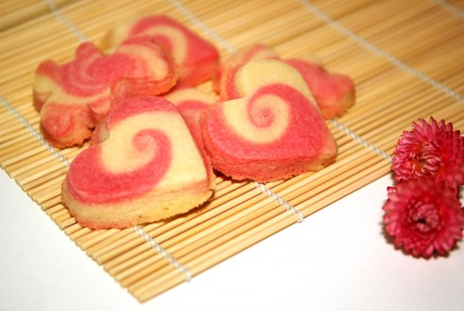 To make these, tint half the dough red, roll the two doughs together, and slice before cutting into heart shapes.