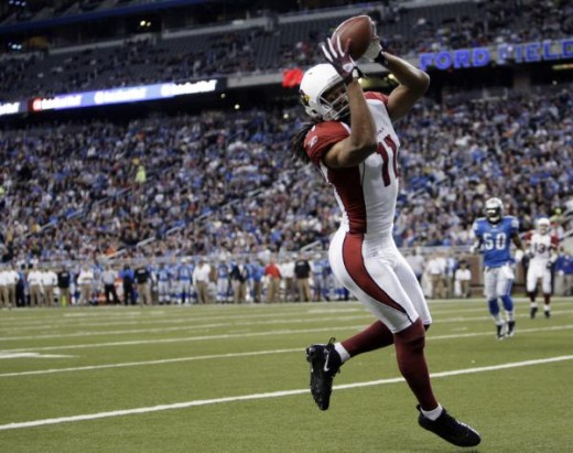 catches a one-yard touchdown-reception against the Detroit Lions in the first quarter of an NFL football game in Detroit, Sunday, Dec. 20, 2009. (AP Photo/Paul Sancya)
