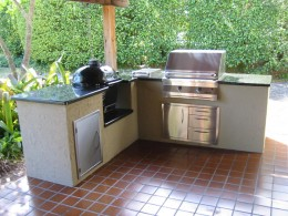 This outdoor kitchen has a Solaire Infrared gas grill and a ceramic kamado barbeque/smoker.