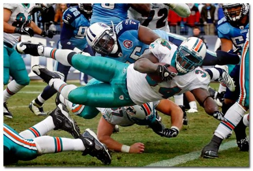 Ricky Williams dives into the endzone for a 1 yard touchdown (Wade Payne Associated Press)