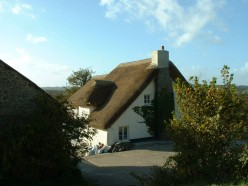 The new thatch - but there is still a lot of work to do on the house.