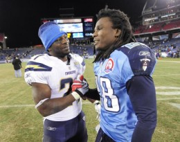 San Diego Chargers running back LaDainian Tomlinson, left, shakes hands with Tennessee Titans running back Chris Johnson after the Chargers defeated the Titans 42-17 in an NFL football game on Friday, Dec. 25, 2009, in Nashville, Tenn. (AP Photo/John