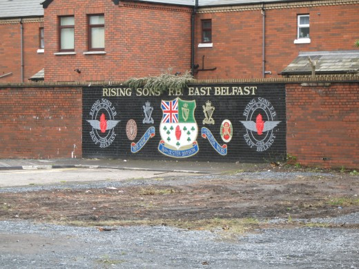A typical Belfast Mural - a paramilitary painting on a wall in East Belfast