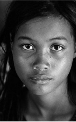 A Nick Rain image. A young Cambodian girl from a rural villiage who is at high risk of being trafficked.