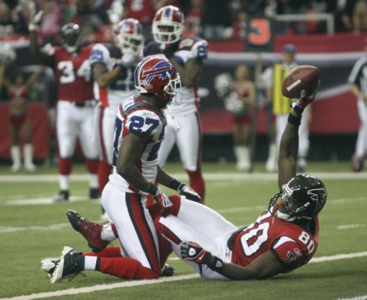 Atlanta Falcons wide receiver Marty Booker (80) reacts after scoring a touchdown defended by Buffalo Bills cornerback Reggie Corner (27) during the second half of an NFL football game, Sunday, Dec. 27, 2009, in Atlanta. Atlanta won 31-3. (AP Photo/Jo