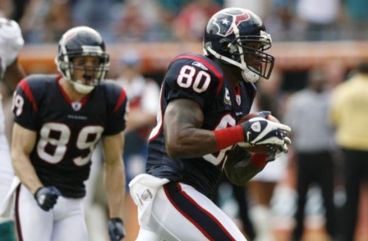 Houston Texans wide receiver Andre Johnson (80) runs on his way to scoring a touchdown in the first quarter against the Miami Dolphins during an NFL football game in Miami, Sunday, Dec. 27, 2009. Texans wide receiver David Anderson (89, looks on. (AP