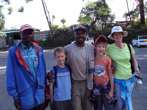Arden and her boys with their Kilimanjaro guide and porter