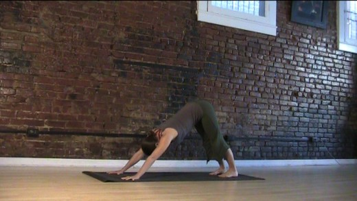 Downward Dog - Make sure you keep your lower back long, not rounded up. Bend your knees if you need to. Your heels do not need to touch the ground.