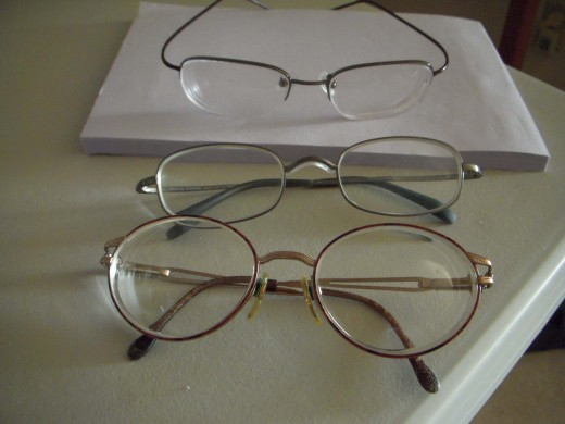 From Top to Bottom: $55.90 eyeglasses from Internet, $600 eyeglasses from optical shop, $200 eyeglasses from optical shop.