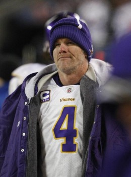 Brett Favre looks on from the sideline in overtime during the Chicago Bears' 36-30 win in an NFL football game in Chicago, Monday, Dec. 28, 2009. (AP Photo/Charles Rex Arbogast)