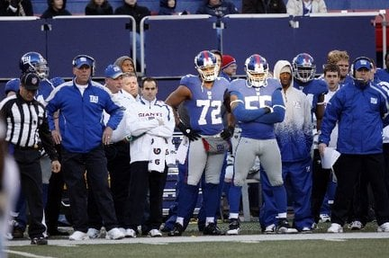 NY Giants defensive end Osi Umenyiora (72) stands on the sidelines and watches as his team is blown out by the Carolina Panthers, 41-9, in the final Giants game at Giants Stadium on Sunday. (Andrew Mills/The Star-Ledger)