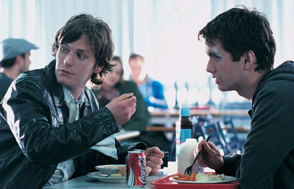 Ben(left) and friend Sean Higgins(Right) looking towards Suzy in college canteen after break-up